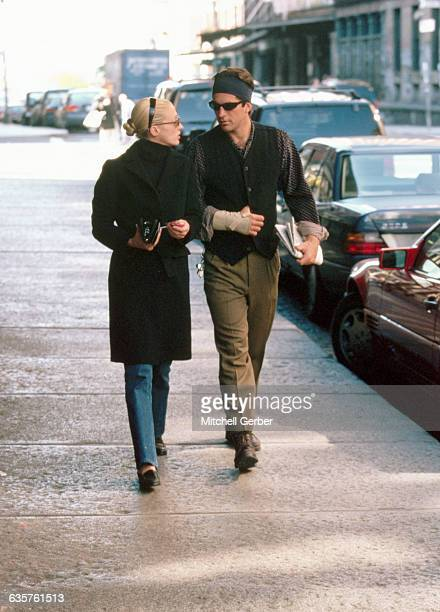 New York NY John F Kennedy Jr walks with wife Carolyn Bessette