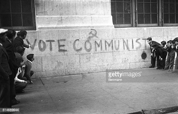 New York NY Although it was probably meant for their elders this specimen of Communist propaganda is being examined by a few school children from the...