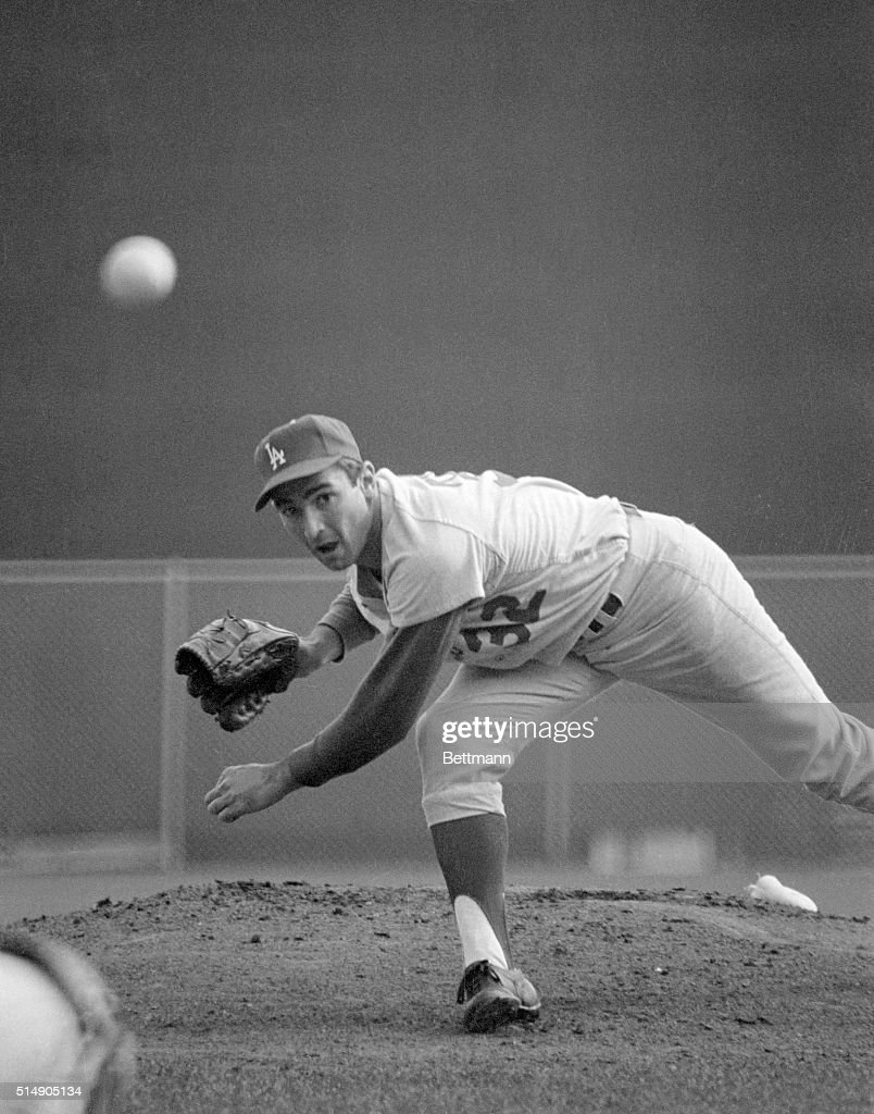 The big gun for the Dodgers in the 1965 World Series is Sandy Koufax, and here he lets go one of his best during the last game of the Series against the Minnesota Twins. Koufax shut out the Twins 2-0 in the last, deciding game and brought the title home to Los Angeles.