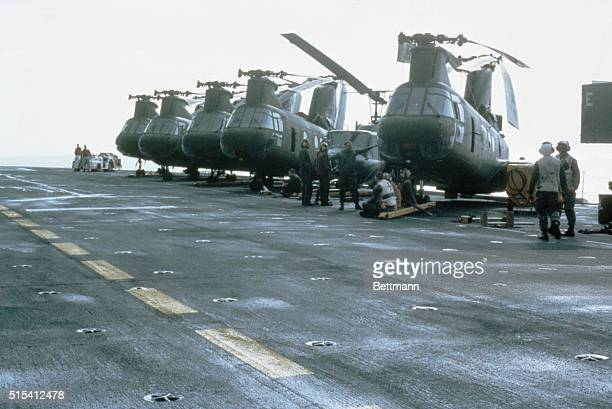 A row of United States military transport helicopters stand at ready during the United States invasion of the island of Grenada