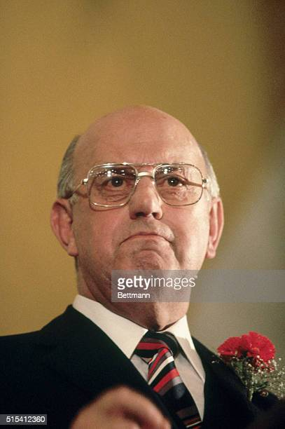 Closeup of PW Botha Prime Minister of South Africa standing at a podium during a press conference He is grimacing