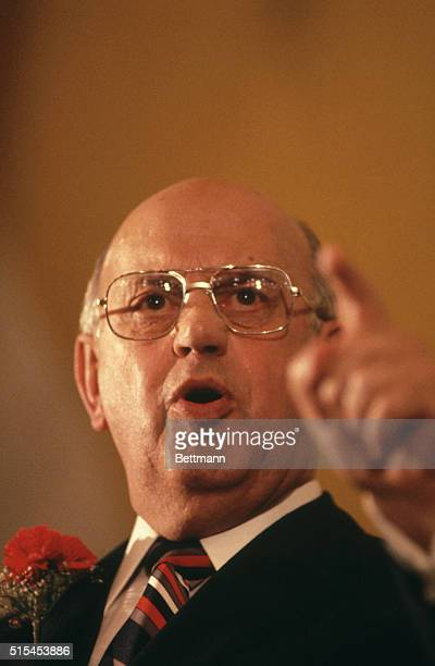Closeup of PW Botha Prime Minister of South Africa standing at a podium during a press conference He is making a point with his finger