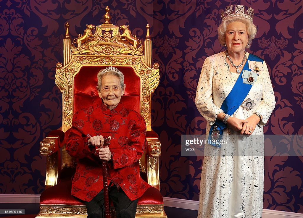 101-year-old Li Xianying poses with a wax figure of Britain's Queen Elizabeth II at Madame Tussauds on October 11, 2013 in Wuhan, China. Wuhan Evening News and Huaxia Qianqiu Education Foundation selected ten healthy centenarians in Wuhan city, and invited them to visit the Madame Tussauds to celebrate the Double Ninth Festival.