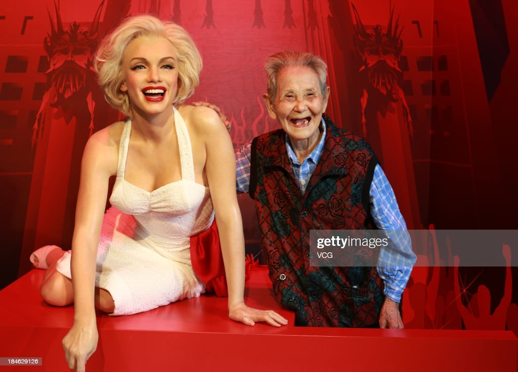 101-year-old Li Xianying poses with a wax figure of Marilyn Monroe at Madame Tussauds on October 11, 2013 in Wuhan, China. Wuhan Evening News and Huaxia Qianqiu Education Foundation selected ten healthy centenarians in Wuhan city, and invited them to visit the Madame Tussauds to celebrate the Double Ninth Festival.