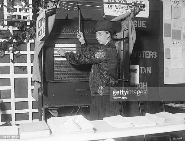 New York NYPhoto shows Mrs Franklin D Roosevelt using voting machine at the Women's Art and Industries Exhibit at the Hotel Commodore