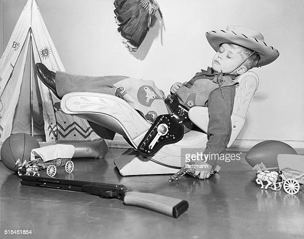 New York New YorkGunfighters of the Old West would turn green with envy if they could see how the modern cowpuncher relaxes Fouryearold Peter...