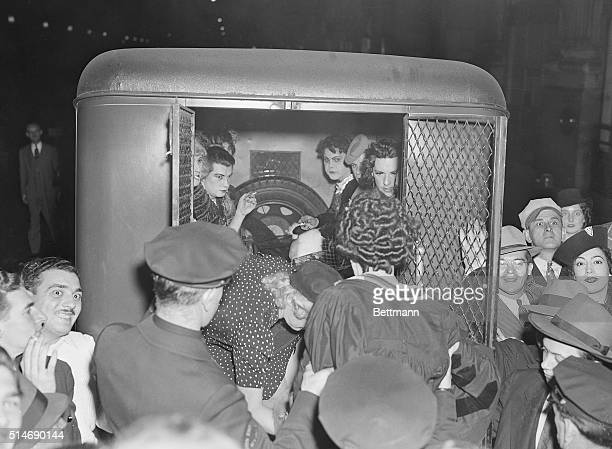 A group of revelers all garbed as women are shown being loaded into a piewagon as police raided a masque ball Manhattan Center early this morning Six...