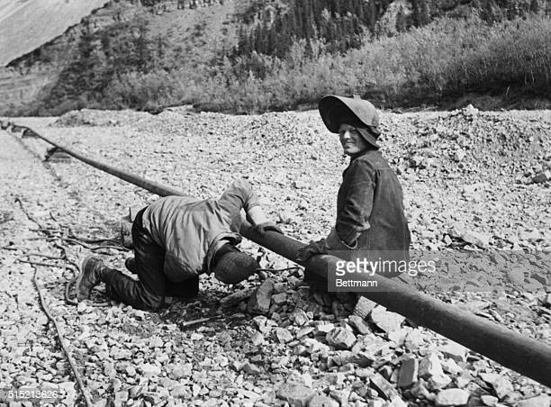 10/21/43Whitehorse Alaska These welders are working on construction of the oil pipeline that will bring vital oil from the Norman Wells Oilfield on...