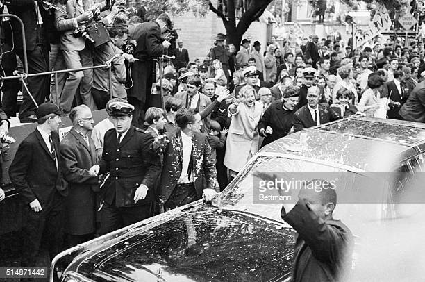 Melbourne, Australia: While some cheer, others jeer as Secret Service agents and police surround President Lyndon Johnson's car after it was smeared...