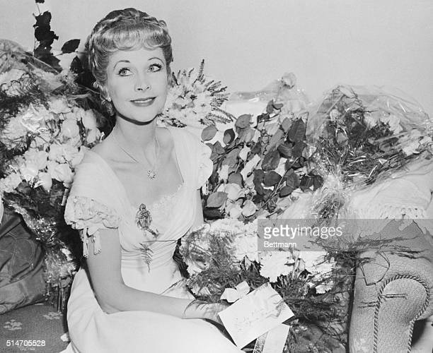 10/2/1953Manchester England Actress Vivien Leigh matches her own beauty with that of the flowers surrounding her in her dressing room at the Opera...
