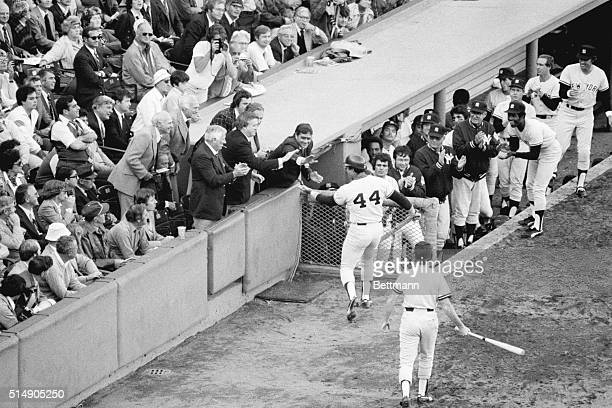 Boston, MA: Reggie Jackson is congratulated by Yankees owner George Steinbrenner and Yanks Vice-President Al Rosen after belting a home run in the...