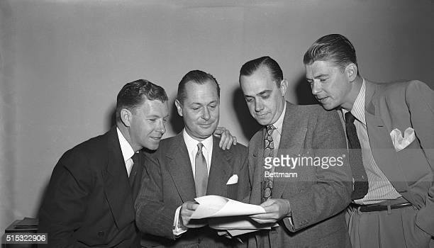 Washington DC Huddled in conference before the a session of the House UnAmerican Activities Committee are actor George Murphy actor Robert Montgomery...