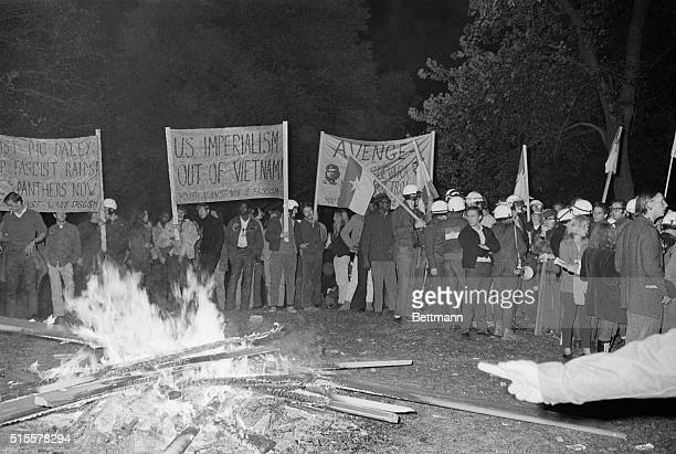 Demonstrators gather in Lincoln Park around a bonfire October 8 to mourn Che Guevara on the anniversary of his death They threatened to burn pig city...