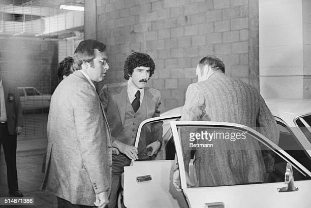 Los Angeles, CA: Kenneth Bianchi gets out of a sheriff's car on arrival at Criminal Courts Building here for arraignment on charges that he murdered...