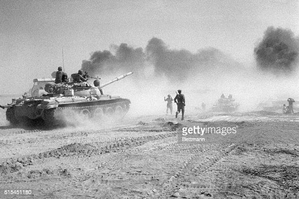 Basra, Iraq- Iraqi troops riding in Soviet-made tanks head for a pontoon bridge in an effort to cross the Karum River northeast of Khurramshahr. The...