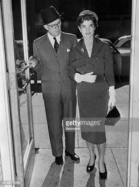 New York: Joseph P. Kennedy, former ambassador to England and father of Senator John Kennedy, is shown with his daughter-in-law, Jacqueline Kennedy,...