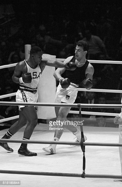 Tokyo Japan Joe Frazier of Philadelphia throws a left at Germany's Hans Huber during their Olympic heavyweight boxing match here Oct 13 Frazier won...