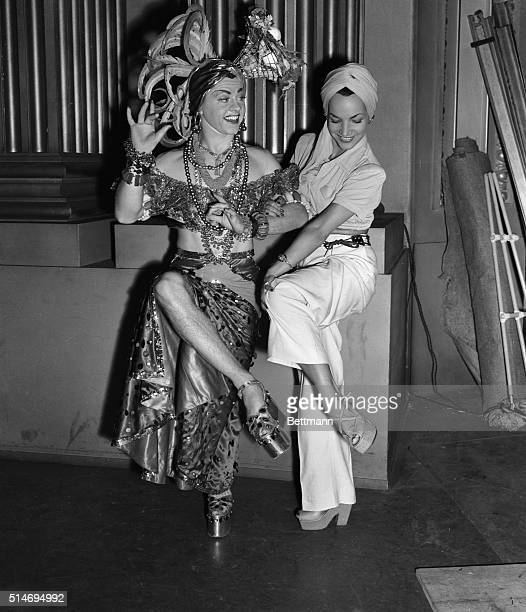 10/23/41Hollywood California Irrepressible Mickey Rooney does a Carmen Miranda impersonation for the real Carmen who paid Mickey a visit on the movie...