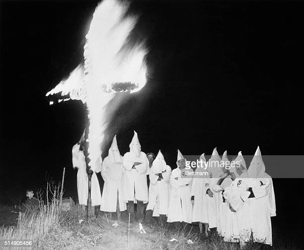 Kalamazoo MI Hooded members of a southwestern Michigan Klavern of the Ku Klux Klan are pictured burning a fiery cross here at the rebirth of Klan...