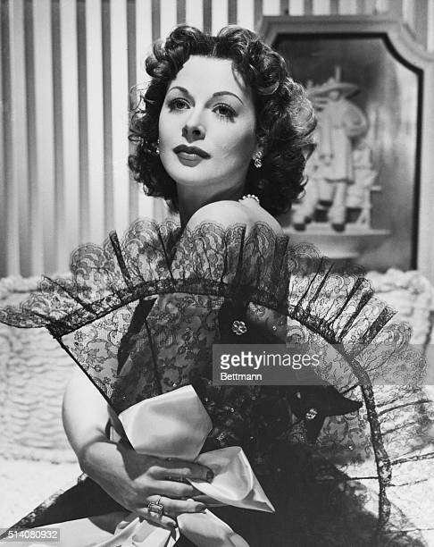 Hollywood CA They really seem to go togetherbeautiful Hedy Lamarr and this elegant ribbontrimmed black lace fan with a large bow of soft satin ribbon...