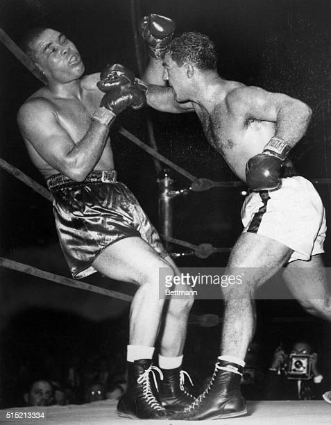 New York, NY- Action shot of Joe Louis being knocked out by Rocky Marciano in the last fight of Louis' career.