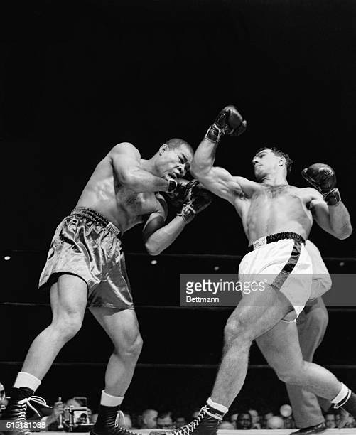 New York NY Joe Louis appears shaken by a right uppercut from Rocky Marciano during their scheduled 10round bout at Madison Square Garden Heavyweight...