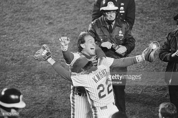 New York NY Mets' Gary Carter and Ray Knight batting stars of the championship game embrace after victory over Boston in the World Series