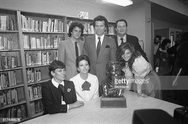 New York, New York-Six sons and daughters of John Wayne crowd around a bust of the late actor during the dedication of the John Wayne Elementary...