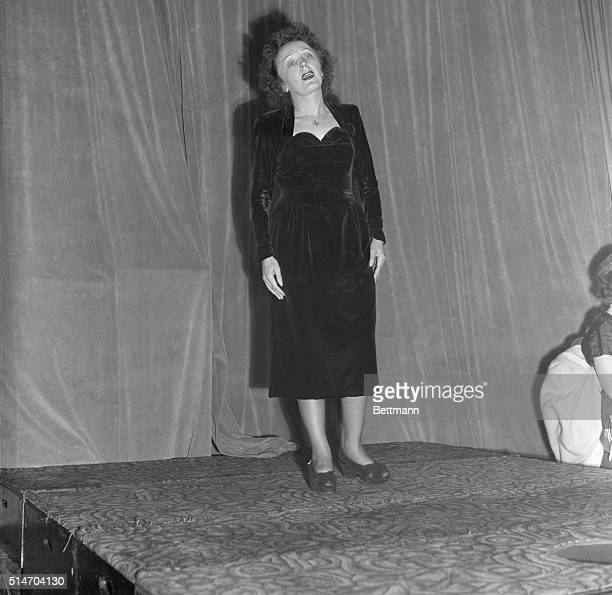 New York NY Nightclub singer Edith Piaf carries on the show at a swanky New York night club the Versailles during the evening of the same day she...