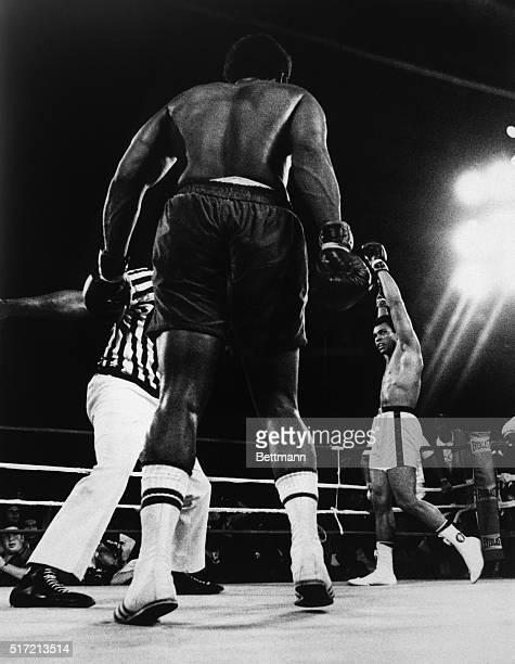 Kinshasa, Zaire: A triumphant Muhammad Ali raises his glove after regaining the World Heavyweight championship. UPI