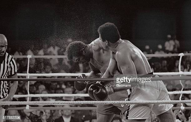 Kinshasa, Zaire: Muhammad Ali smashes a right to the head of George Foreman.