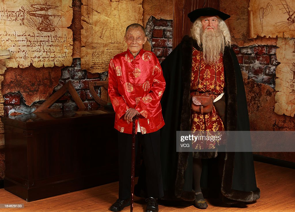 102-year-old Xiong Lixing poses with a wax figure of Leonardo Da Vinci at Madame Tussauds on October 11, 2013 in Wuhan, China. Wuhan Evening News and Huaxia Qianqiu Education Foundation selected ten healthy centenarians in Wuhan city, and invited them to visit the Madame Tussauds to celebrate the Double Ninth Festival.