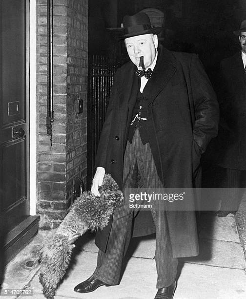 London England Winston Churchill is greeted at the door of his London home by Rufus his twoyearold miniature red poodle Rufus wants to hear all about...