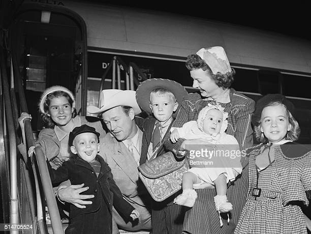 Los Angeles CowboyActor Roy Rogers and actress wife Dale Evans arrive by plane in Los Angeles Bringing with them two newly adopted children five year...
