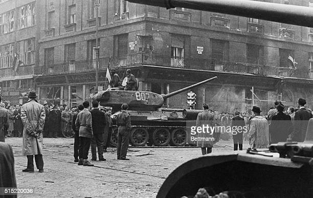 Budapest Hungary A captured Soviet tank flies the Hungarian red white and green flag as its Hungarian crew prepares to enter it into the fray against...