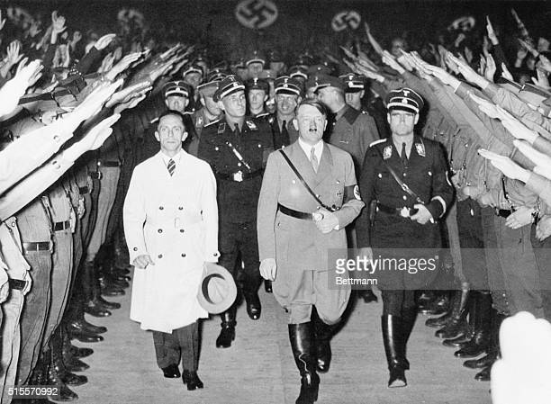 Berlin, Germany- Chancellor Adolf Hitler & Minister of Propaganda Joseph Goebbels receiving the cheers and Nazi salutes of their followers in the...