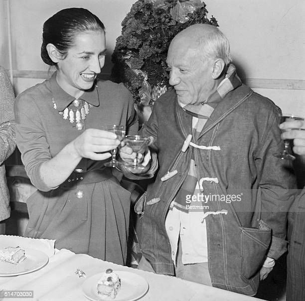 Vallauris France Pablo Picasso famed Spanish painter born at Malaga on Oct 25 clinks glasses with his wife Francoise as they toast the artist's 70th...