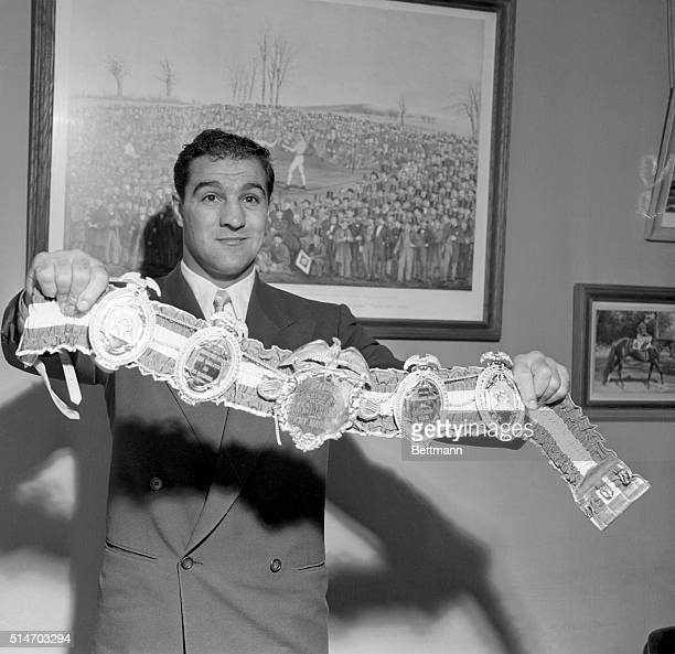 New York NY World Heavyweight champion Rocky Marciano of Brockton MA displays the Ring Magazine belt presented to him for winning the title last...