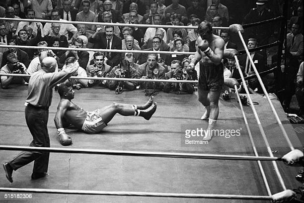 Los Angeles, California- Referee Vern Bybee waves Jerry Quarry to a neutral corner after the 22-year-old Californian had former two-time champion...