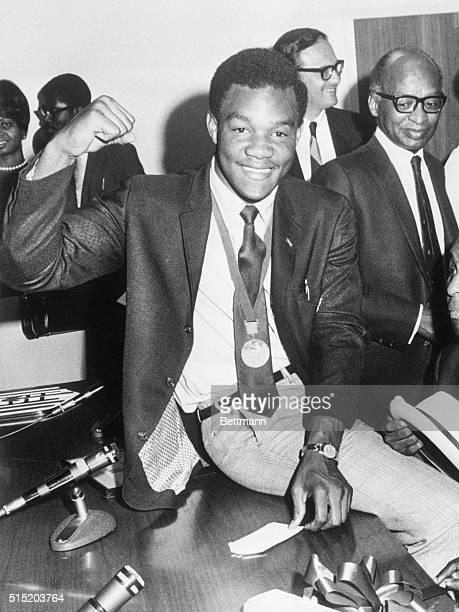 10/31/68Washington DC Olympic heavyweight boxing champion George Foreman wearing his newly won gold medal visits Job Corps headquarters where he...