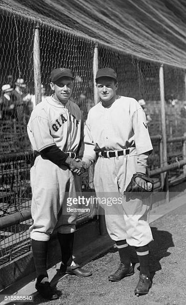 Bill Terry and Joe Cronin, the player/managers of the New York Giants and the Washington Senators shake hands before the start of the first World...