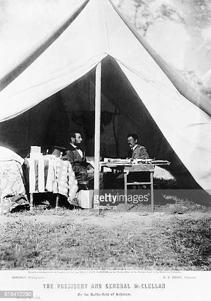 10/4/1862Antietam Maryland President Abraham Lincoln with General George Brinton McClellan talking in a tent at the Antietam battlefield Undated...