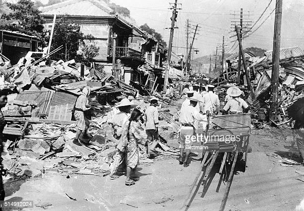 Tokyo, Japan- Cleaning up the wreckage: Tokyo began to clean her streets of debris Monday morning, despite the quakes that continued.