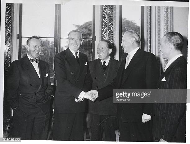 10/4/1954London England British Foreign Secretary Anthony Eden shales hands with West German Chancellor Konrad Adenuer after the signing of the nine...