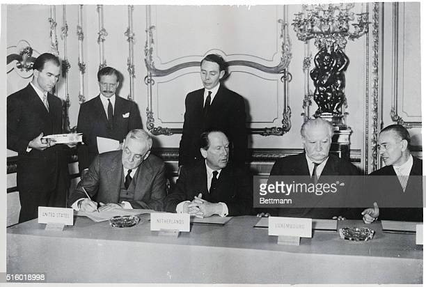 10/4/1954London England United States Secretary of State John Foster Dulles signs the nine power pact that concluded the conference on the rearming...