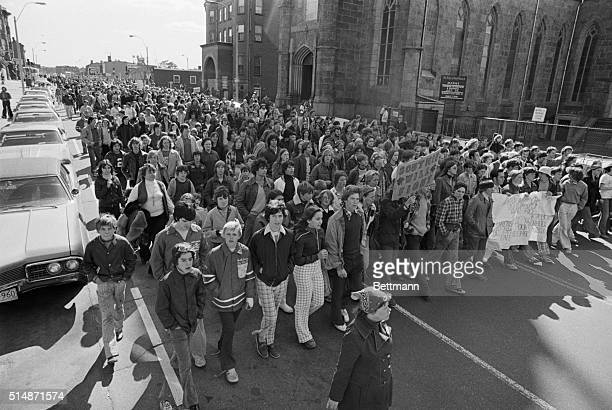 Thousands of white students boycotted classes and joined their parents in a noisy 3 1/2mile protest march through South Boston 10/4 on the 16th day...