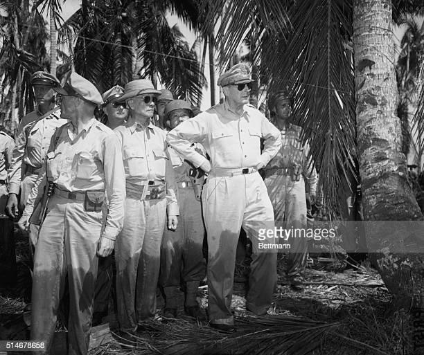 10/44Leyte Phillipine Islands MacArthur with Colonel Iehrbas Sergio Osmena and Brg Gen Romulo on Leyte Mac's trousers are wet to knees after wading...