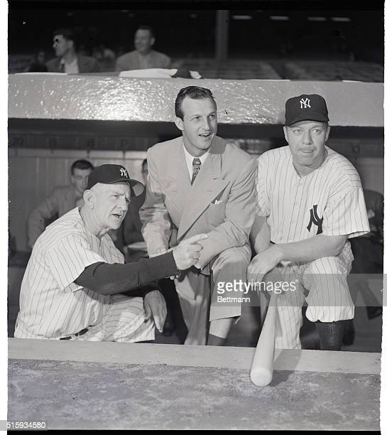 10/5/1951New York NY Yankee manager Casey Stengel points out some strategic locations to World Series spectator Stan Musial of the St Louis Cards Ed...