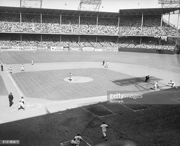 New York, NY: Here's a view of the diamond at Ebbets Field during the round-the-horn double play that broke up a Dodger threat in the first inning of...