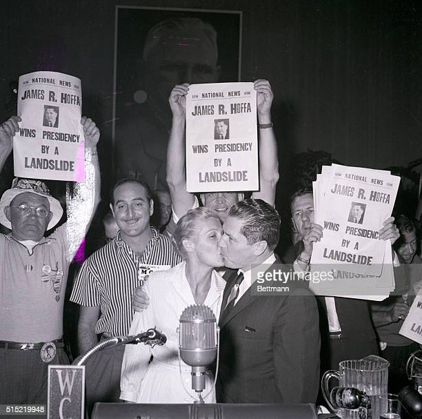 10/5/1957Miami Beach FL While a delegate gives the Teamsters the tidings via a huge poster newly elected president James R Hoffa gets a...